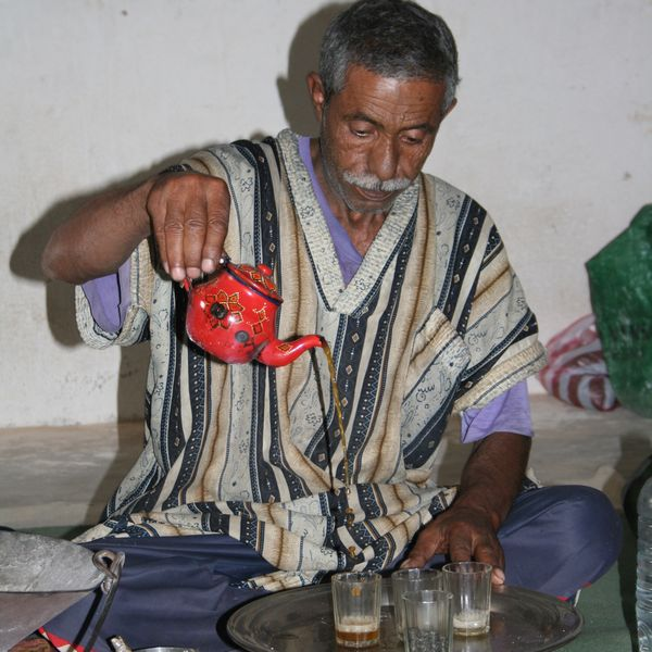 Moroccan man pouring mint tea